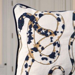 Cushion with orobouros embroidered pattern designed by Victoria Maria Geyer for Pierre Frey
